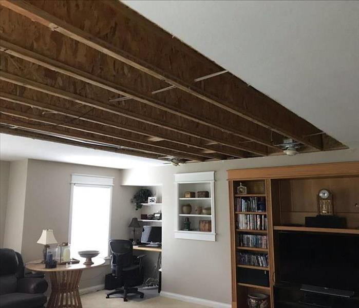 A ceiling with panels removed due to water damage.