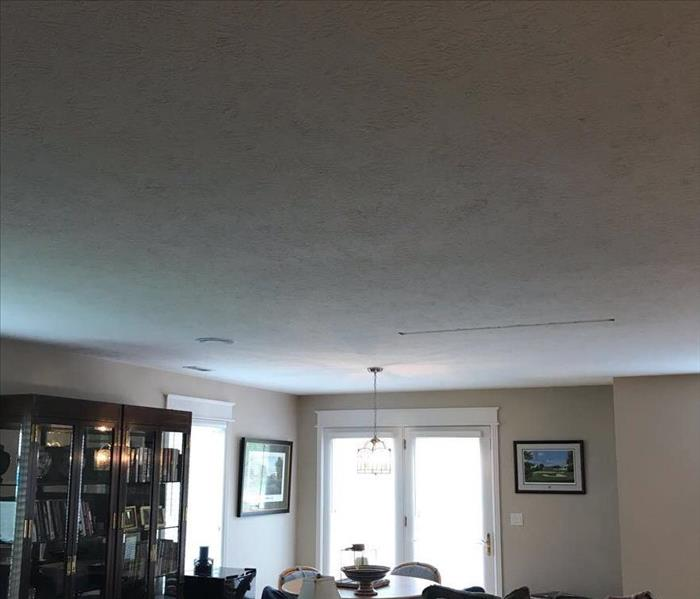 A fully repaired ceiling that once had water damage.