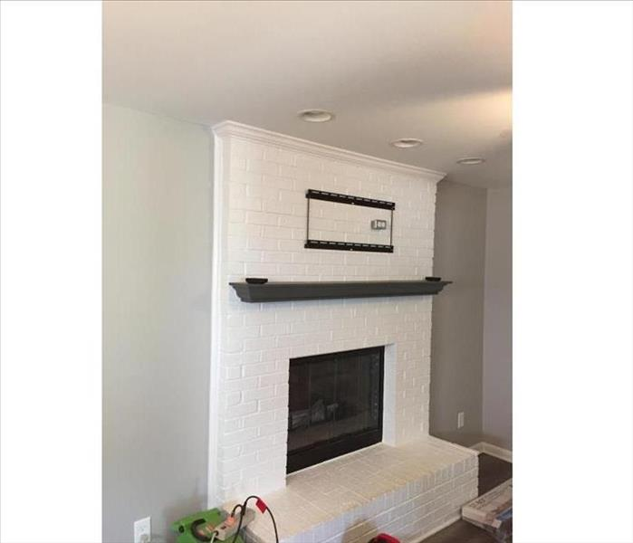 A renovated, brand-new fireplace.