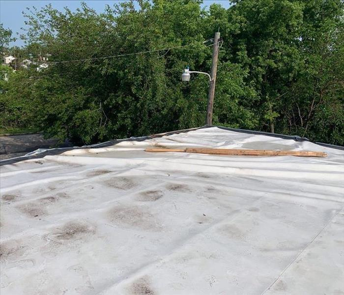 Recently storm damaged roof covered with