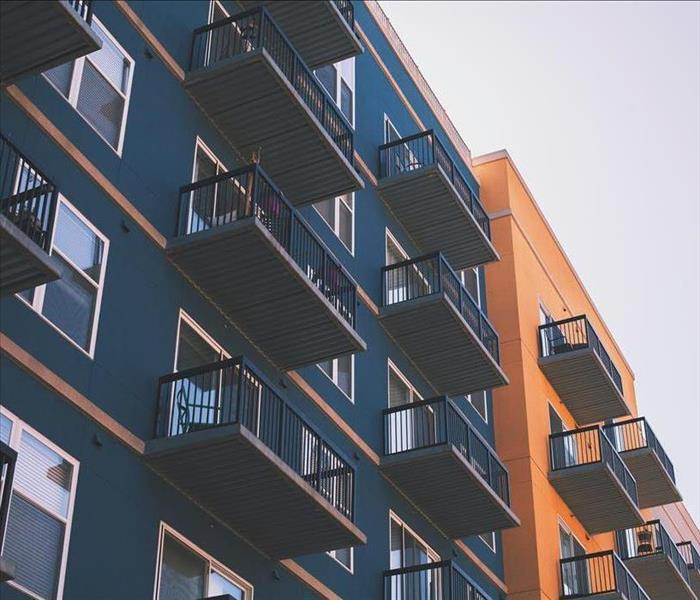 A perspective from below of the balconies of an apartment building.