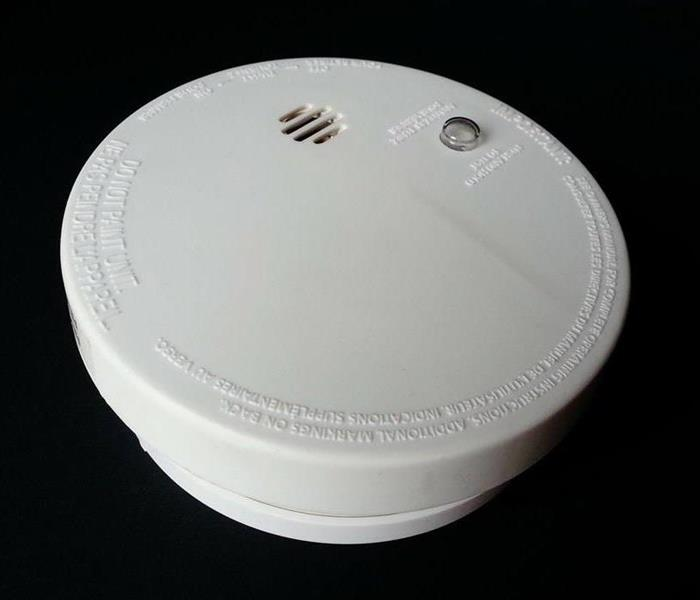 photoelectric smoke detector on wall